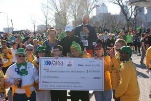 TMNA Services presents their $10,000 presenting sponsor check to Special Olympics Philadelphia athletes